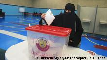 Qataris vote in legislative elections in Doha, Qatar, Saturday, Oct. 2, 2021. For the first time citizens will elect two-thirds of Shura council while emir will appoint the remaining 15 members. (AP Photo/Hussein Sayed)