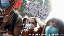 People take part in the 'Global march for climate justice' while environment ministers meet ahead of Glasgow's COP26 meeting, in Milan, Italy, October 2, 2021. REUTERS/Guglielmo Mangiapane