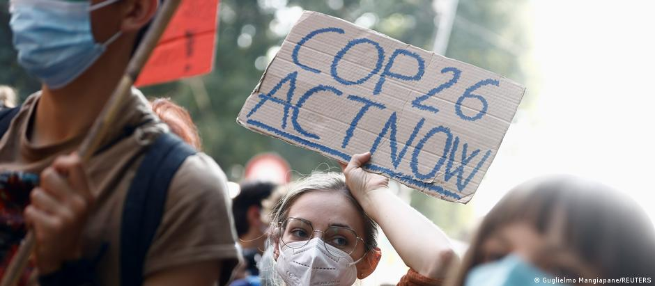 People take part in the global march for climate justice inb Milan, Italy, while environment ministers meet ahead of Glasgow's COP26 meeting