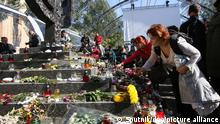 6664865 03.10.2021 People lay flowers at the Menorah Monument commemorating victims of the Babiy Yar massacre, in Kiev, Ukraine. Babiy Yar, the large ravine on the northern Kiev outskirts, is known as the mass killing site where during WWII Nazis executed almost all Jews in Kiev, many other city residents, prisoners of war and gypsies, with a total number of victims estimated to be more than 100,000 people. Stringer / Sputnik