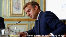 TOPSHOT - France's President Emmanuel Macron takes part in a virtual G7 summit to discuss the crisis in Afghanistan at the Elysee Palace in Paris on August 24, 2021. - Efforts to evacuate thousands of people from Taliban-controlled Afghanistan became increasingly urgent, as European nations said they would not be able to evacuate all at-risk Afghans before next week's deadline. (Photo by SARAH MEYSSONNIER / POOL / AFP) (Photo by SARAH MEYSSONNIER/POOL/AFP via Getty Images)
