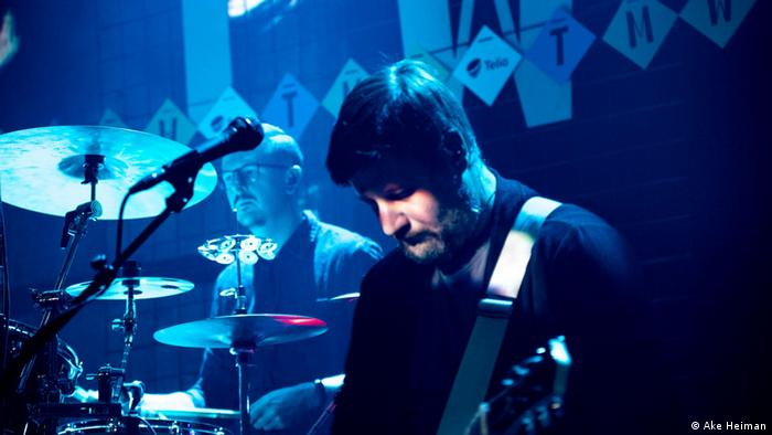 Rainday Station's drummer Kirill Harjo in back, with guitarist Arseni Grigorjev up front on stage.