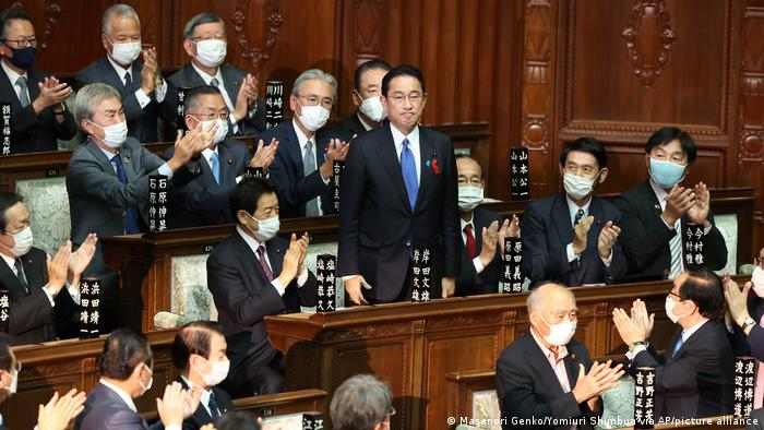 Kishida reacts after being chosen as prime minister