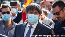 Catalan separatist leader Carles Puigdemont arrives at a courthouse in Sardinia, as a judge holds the first hearing on his European arrest warrant, in Sassari, Italy, October 4, 2021. REUTERS/Guglielmo Mangiapane