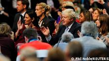 Britain's Prime Minister Boris Johnson applauds as he attends the annual Conservative Party conference, in Manchester, Britain, October 4, 2021. REUTERS/Phil Noble