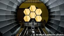 Handout photo dated April 15, 2011 of NASA engineer Ernie Wright looks on as the first six flight ready James Webb Space Telescope's primary mirror segments are prepped to begin final cryogenic testing at NASA's Marshall Space Flight Center. Last summer, NASA and the European Space Agency (ESA) set an October 31, 2021, launch date for the $ 10 billion James Webb Space Telescope, but it's having to delay the science observatory's trip into space once again. Thankfully, the launch might take place just a few weeks later, in November or early December. A rescheduled date is unlikely to be confirmed until later this summer or perhaps in the fall. The instrument, successor to NASA's Hubble Space Telescope, which is the largest science observatory ever placed into space, will launch on a European Ariane 5 rocket from a spaceport in French Guiana. Photo by NASA via ABACAPRESS.COM