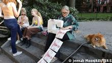 Elena Berriolo sews photos of uteri as supporters of reproductive choice take part in the nationwide Women's March, held after Texas rolled out a near-total ban on abortion procedures and access to abortion-inducing medications, at Washington square park in New York City, New York, U.S. October 2, 2021. REUTERS/Jeenah Moon