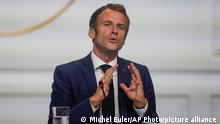 French President Emmanuel Macron gestures as he speaks during the One Planet Summit at the Elysee Palace in Paris, Monday, Oct. 4, 2021. France, with the United Nations and the World Bank, is organizing a 'One Planet Summit' for biodiversity in Paris. (AP Photo/Michel Euler, Pool)