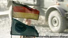 Eine deutsche Flagge und eine Fahne der ISAF wehen am Montag (06.10.2008) im Bundeswehr-Feldlager Feisabad an der Funkantenne eines Lastwagens. Der Bundestag berät im Oktober über die Verlängerung des Mandates um 14 Monate und die Aufstockung des Kontingents um 1000 Soldaten auf dann bis zu 4500 Soldaten am Hindukusch. Foto: Maurizio Gambarini +++(c) dpa - Report+++