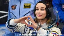 6665891 05.10.2021 Actress Yulia Peresild of the ISS Expedition 66 prime crew puts on her spacesuit at the Baikonur Cosmodrome, in Baikonur, Kazakhstan. The launch of the Soyuz MS-19 mission to be involved in making the feature film The Challenge aboard the International Space Station is scheduled for 5 October 2021 at 11:55 Moscow time from the Baikonur Cosmodrome. Actor Yulia Peresild and director Klim Shipenko are set to blast off Tuesday for the International Space Station in a Russian Soyuz spacecraft together with cosmonaut Anton Shkaplerov, a veteran of three space missions. After 12 days on the space outpost, Peresild and Shipenko will return to Earth with another Russian cosmonaut. Ramil Sitdikov / Sputnik