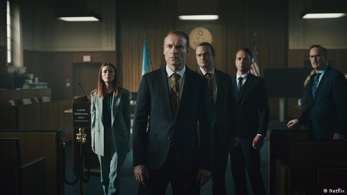 Film still from 'The Billion Dollar Code' a group of people in suits in a US court