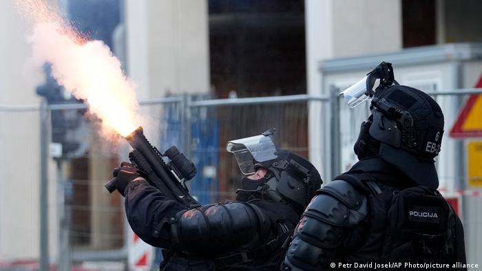 Police fire tear gas during a protest against vaccinations and coronavirus measures in Ljubljana, Slovenia