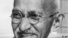 ** FILE ** Indian leader Mohandas K. Gandhi, also known as Mahatma Gandhi, smiles in this 1947 file photo, location unknown. The great-grandson of Mohandas K. Gandhi said Monday Feb. 22, 2009, that he has launched a fundraising campaign to buy a rare collection of the Indian independence leader's personal items that are up for auction and bring them back to India. (AP Photo/File)
