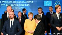 6.10.2021***Germany's Chancellor Angela Merkel (C), European Council President Charles Michel (L) and Cyprus' President Nicos Anastasiades (CR) arrive for the family photograph during the EU-Western Balkans summit at Brdo Congress Centre, near Ljubljana on October 6, 2021. - Western Balkan countries can expect reassurances but no concrete progress on their stalled bids for European Union membership when EU leaders meet today. (Photo by Joe Klamar / AFP)
