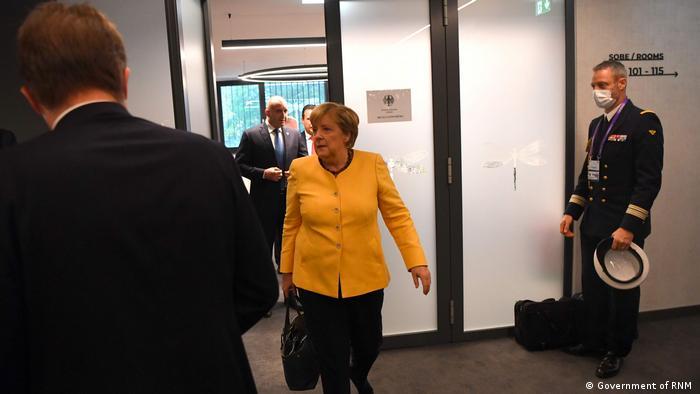 Angela Merkel walking with handbag