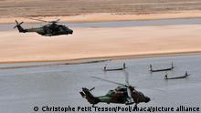 2017***File photo - French President Emmanuel Macron (up) flies over Gao inside a military helicopter during a visit to France's Barkhane counter-terrorism operation in Africa's Sahel region, northern Mali, 19 May 2017. French President's visit in Mali is his first trip outside Europe since his inauguration on 14 May 2017. - The French army announced the neutralization in Mali, by the Barkhane force of Bah ag Moussa, military leader of the Rally for the Victory of Islam and Muslims (RVIM), a group affiliated with Al-Qaeda, and the one of the historical cadres of the jihadist movement in the Sahel. Photo by Christophe Petit Tesson/Pool/ABACAPRESS.COM