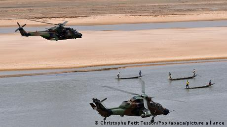French President Emmanuel Macron (up) flies over Gao inside a military helicopter during a visit to France's Barkhane counter-terrorism operation in Africa's Sahel region, northern Mali, 19 May 2017.