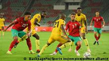 Football - Qatar 2022 FIFA World Cup Qualifier - Morocco v Guinea-Bissau - Prince Moulay Abdallah Stadium - Rabat - Morocco. Imran Louza of Morocco attempts to get past Nanu of Guinea Bissau during the Qatar 2022 FIFA World Cup qualifier between Morocco and Guinea-Bissau held at Prince Moulay Abdallah Stadium in Rabat, Morocco on 6 October 2021 © Sports Inc URN:62913690