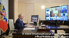 MOSCOW REGION, RUSSIA - OCTOBER 6, 2021: Russia's President Vladimir Putin chairs a meeting on the energy sector development via a video linkup from Novo-Ogaryovo residence. Alexei Druzhinin/Russian Presidential Press and Information Office/TASS