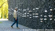 Crystal Wailing Wall unveiled at Babi Yar memorial site in Kiev, KIEV, UKRAINE - OCTOBER 6, 2021: Svyatoslav Vakarchuk, the founder of the Voice Party, the frontmant for the rock band Okean Elzy, attends a ceremony to unveil the Crystal Wailing Wall at the Babi Yar memorial site and mark the 80th anniversary of the largest local WWII massacre. Babi Yar is a ravine in the northwestern part of the Ukrainian capital, where Nazi German troops and local collaborationists carried out mass executions of Jewish and Roma civilians as well as Soviet prisoners of war. Irina Yakovleva/TASS