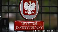 A sign is seen at the entrance of the Constitutional Tribunal in Warsaw, Poland on September 22, 2021. On Wednesday the Tribunal was set to rule if EU law has primacy of the Polish constitution. The matter concerns a ruling of the Court of Justice of the European Union demanding Poland dismantle a disciplinary chamber which is part of the Supreme Court and is judged by the EU as being a political tool. Today's hearing will be resumed on September 30 further prolonging one of the most contentious issues between Poland and the EU. (Photo by STR/NurPhoto)