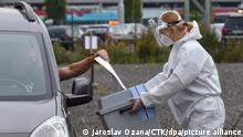 Quarantined people vote in the drive-in special election point for quarantined people due to covid-19 in Ostrava, October 6, 2021. (CTK Photo/Jaroslav Ozana)