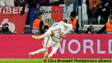 France's Theo Hernandez celebrates with France's Karim Benzema after scoring his side's third goal during the UEFA Nations League semifinal soccer match between Belgium and France at the Juventus stadium, in Turin, Italy, Thursday, Oct. 7, 2021. (AP Photo/Luca Bruno)