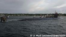In this image released by the US Navy, The Seawolf-class fast-attack submarine USS Connecticut (SSN 22) departs Naval Base Kitsap-Bremerton for deployment in Bremerton, Washington on May 27, 2021. - A US nuclear submarine was damaged after hitting an unidentified object while operating underwater in Asia, the US Navy said. The USS Connecticut, a nuclear-powered fast-attack submarine, struck an object while submerged on the afternoon of Oct. 2, while operating in international waters in the Indo-Pacific region, the navy said in a statement. (Photo by Lt. Mack Jamieson / US NAVY / AFP) / RESTRICTED TO EDITORIAL USE - MANDATORY CREDIT AFP PHOTO / US Navy/ Lt. Mack JAMIESON - NO MARKETING - NO ADVERTISING CAMPAIGNS - DISTRIBUTED AS A SERVICE TO CLIENTS