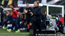 HAMBURG, GERMANY - OCTOBER 08: Germany's head coach Hans-Dieter Flick gives instructions during the 2022 FIFA World Cup Qualifier match between Germany and Romania at Imtech Arena on October 08, 2021 in Hamburg, Hamburg. (Photo by Martin Rose/Getty Images)