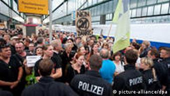 Protestors contront police in train station