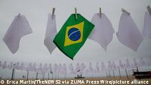 October 8, 2021, Rio de Janeiro, Rio de Janeiro, Brasil: (INT) Rio de Paz NGO makes an act in memory of over 600 thousand Brazilians killed by COVID-19. October 8, 2021, Rio de Janeiro, Brazil: Rio de Paz NGO performs an act in memory of the 600 thousand Brazilians killed by COVID-19, on Copacabana beach, South Zone of Rio..Credit: Erica Martin/Thenews2 (Foto: Erica Martin/TheNews2/Zumapress) (Credit Image: © Erica Martin/TheNEWS2 via ZUMA Press Wire