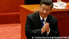 Chinese President Xi Jinping applauds at a meeting commemorating the 110th anniversary of Xinhai Revolution at the Great Hall of the People in Beijing, China October 9, 2021. REUTERS/Carlos Garcia Rawlins