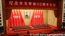 A giant portrait of Sun Yat-sen hangs above Chinese President Xi Jinping and other leaders attending a meeting commemorating the 110th anniversary of Xinhai Revolution at the Great Hall of the People in Beijing, China October 9, 2021. REUTERS/Carlos Garcia Rawlins