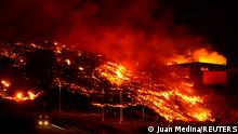 Lava burns buildings following the eruption of the Cumbre Vieja volcano in Tacande, Spain, October 9, 2021. REUTERS/Juan Medina TPX IMAGES OF THE DAY