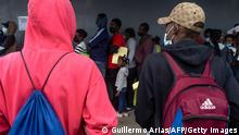 Haitian migrants queue to register with the National Commission for Refugees (COMAR) in Tijuana, Baja California state, Mexico on October 6, 2021, in Mexico. - Many Haitian migrants that were originally heading to the US see Tijuana as an option for seeking asylum as they face stricter immigration controls by Mexican authorities in cities east of the US-Mexico border. (Photo by Guillermo Arias / AFP) (Photo by GUILLERMO ARIAS/AFP via Getty Images)