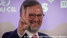 Leader of center-right Spolu (Together) coalition Petr Fiala flashes the V sign as he reacts to election results at the party's election headquarters, Prague, Czech Republic, Saturday, Oct. 9, 2021. The center-right Together coalition was capturing 23.9% of the votes while the center-left coalition of the Pirate Party and STAN, a group of mayors and independent candidates, were coming in third with 13.5% support. (AP Photo/Darko Bandic)