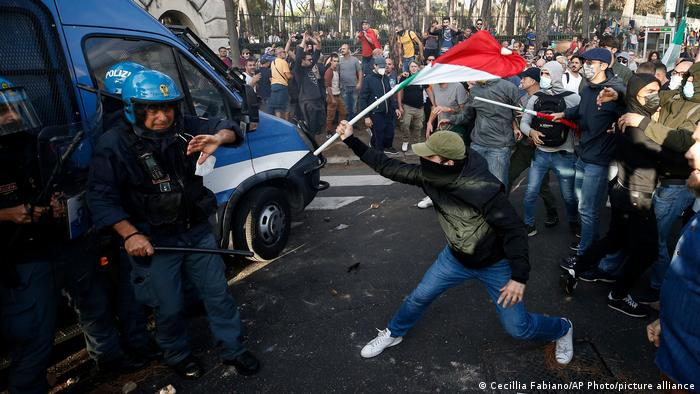 Protesters attack a police van in Rome