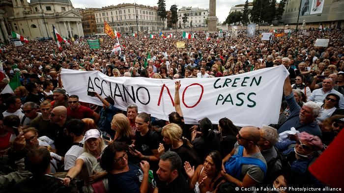 Thousands of people marched against a mandatory COVID certification on Saturday, holding up banners that say 'No Green Pass'