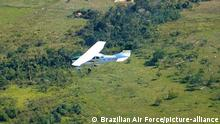 epa01752901 A handout picture released on 05 June 2009, in Rondonia, Brazil, by Brazilian Air Force (FAB) shows a Bolivian aircraft which was intercepted and obliged to landing by the FAB, according to an official report. Authorities said the aircraft was loaded with 176 kilogrames of cocaine and was found on 03 June 2009, close to Alta Floresta d'Oeste Home Town in the amazonico state of Rondonia. EPA/BRAZILIAN AIR FORCE / HO EDITORIAL USE ONLY EDITORIAL USE ONLY/NO SALES