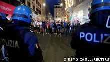 Demonstrators face off police officers during a protest against the government's introduction of the Green Pass near Chigi Palace in Rome, Italy, October 9, 2021. REUTERS/Remo Casilli