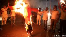FILE PHOTO: Protestors burn an effigy of Yogi Adityanath, Chief Minister of the northern state of Uttar Pradesh, during a protest after people were killed when a car linked to a federal minister ran over farmers protesting against controversial farm laws in Uttar Pradesh on Sunday, in Kolkata, India, October 4, 2021. REUTERS/Rupak De Chowdhuri/File Photo