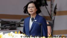 Taiwanese President Tsai Ing-wen delivers a speech during National Day celebrations in front of the Presidential Building in Taipei, Taiwan, Sunday, Oct. 10, 2021. (AP Photo/Chiang Ying-ying)