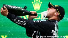 ISTANBUL, TURKEY - OCTOBER 10: Race winner Valtteri Bottas of Finland and Mercedes GP celebrates on the podium during the F1 Grand Prix of Turkey at Intercity Istanbul Park on October 10, 2021 in Istanbul, Turkey. (Photo by Bryn Lennon/Getty Images)