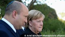 German Chancellor Angela Merkel, right, and Israel's Prime Minister Naftali Bennett, walk during her visit to the Yad Vashem Holocaust Museum in Jerusalem, Sunday, Oct.10, 2021. Germany's lame-duck chancellor, Merkel, paid the final official visit to Israel on Sunday, saying she had been fortunate to play a key role in strengthening relations between the two countries after the horrors of the Holocaust during World War II. (AP Photo/Ariel Schalit)