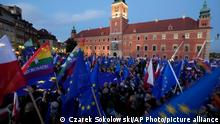 People wave EU and Polish flags in support of Poland's EU membership during a demonstration, in Warsaw, Poland, Sunday, October 10, 2021. Poland's constitutional court ruled Thursday that Polish laws have supremacy over those of the European Union in areas where they clash, a decision likely to embolden the country's right-wing government and worsen its already troubled relationship with the EU. (AP Photo/Czarek Sokolowski)