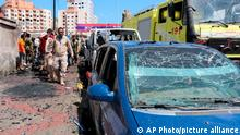 Security personnel prepare to remove a vehicle at the site of a deadly car bomb attack that targeted two senior government officials, who survived, security officials said, in the port city of Aden, Yemen, Sunday, Oct. 10, 2021. Aden has been the seat of the internationally recognized government of President Abed Rabbo Mansour Hadi since the Iranian-backed Houthi rebels took over the capital, Sanaa, triggering Yemen's civil war. (AP Photo/Wael Qubady)