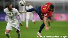 MILAN, ITALY - OCTOBER 10: Ferran Torres of Spain challenges for the high ball with Theo Hernandez of France during the UEFA Nations League 2021 Final match between Spain and France at San Siro Stadium on October 10, 2021 in Milan, Italy. (Photo by Mike Hewitt/Getty Images)