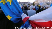 The flags of Poland and European Union are tied together during a rally in support of Poland's membership in the European Union after the country's Constitutional Tribunal ruled on the primacy of the constitution over EU law, undermining a key tenet of European integration, in Rzeszow, Poland, October 10, 2021. Patryk Ogorzalek/Agencja Gazeta via REUTERS THIS IMAGE HAS BEEN SUPPLIED BY A THIRD PARTY. POLAND OUT. NO COMMERCIAL OR EDITORIAL SALES IN POLAND.