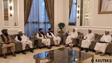 Taliban delegates meet with Qatar delegates in Doha, Qatar, in this handout photo uploaded to social media on October 9, 2021. Picture uploaded on on October 9, 2021. Social media handout/via REUTERS ATTENTION EDITORS - THIS IMAGE HAS BEEN SUPPLIED BY A THIRD PARTY. NO RESALES. NO ARCHIVES.
