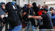 09.10.2021 Demonstrators clash with security personnel during a protest against the government's introduction of the Green Pass in Rome, Italy, October 9, 2021. REUTERS/Remo Casilli